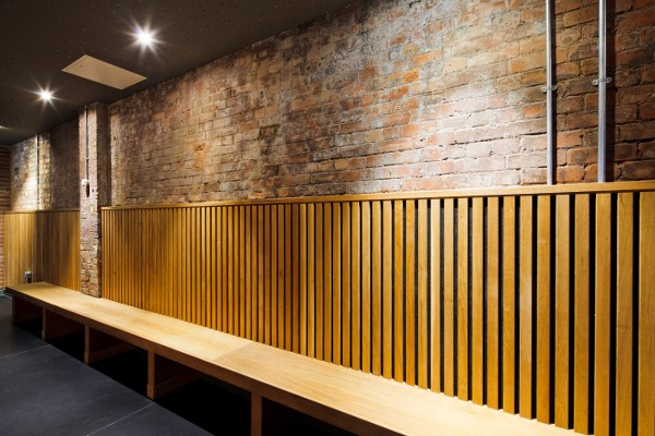 back wall lined with oak seating